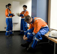 Photo of graduates in PPE gear